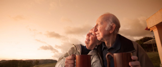 Older-couple-contemplating-memorial-plans-1366x565