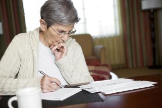 Elderly-woman-doing-paperwork
