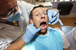Man-in-dentist-chair-The-Belgravia-Centre
